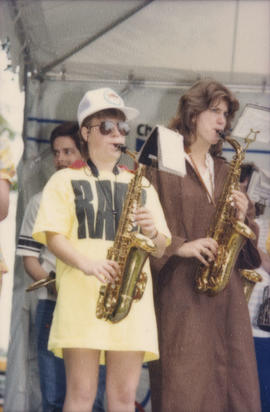 Two women playing saxophone on Chevron Stage