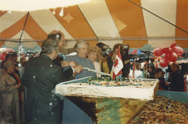 Mike Harcourt and Pat Carney with Grace McCarthy cutting the Canada Day birthday cake