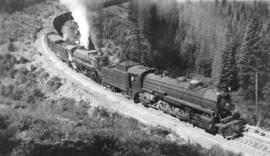 [C. P. R. Steam Engs. #5813 and 5438 and train]
