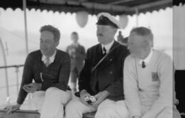 [Yacht racing - three men spectating]