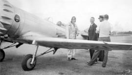 [Pilot Keith Ryder, Mr. Way and Noel Humphries and Joe Bertalino prior to the first non-stop flig...