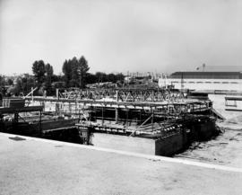 Construction of P.N.E. B.C. building with Pure Foods, and Pavilion of Modern Living in background