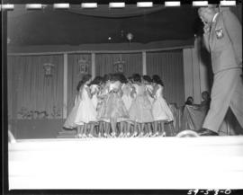Miss P.N.E. 1959 contestants huddled together on Outdoor Theatre stage