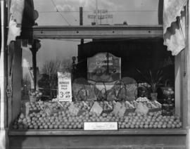 "McTaggart and Son store window, Robson and Howe [""Sunkist"" grapefruit display]"