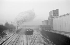 [A steam engine passing Wheat Pool No. 1 elevator]