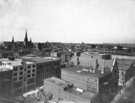 [Looking west from Hastings Street at Homer Street]
