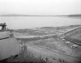 [Partially constructed Kitsilano Pool, showing beach, stone wall and excavated area]