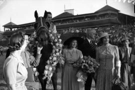 [Miss. Anna Neagle and others with winning horse at Hastings Park]