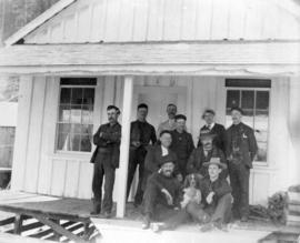 [Unidentified men, dog and building at Rivers Inlet]