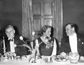 [His Worship George C. Miller, Mrs. W.J. Twiss and Eric W. Hamber at a banquet]