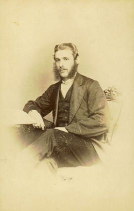 [Seated studio portrait of man]