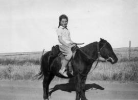 Jane [Banfield riding a horse]