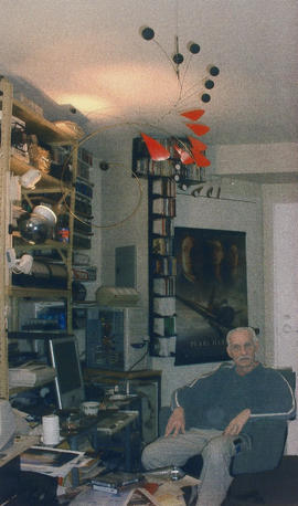 Jack Bischke in his home - above one of his marvelous mobiles