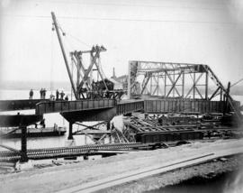 [A group of workers pose during the construction of a spread span]