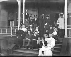 [Unidentified group on the steps of a house numbered 526]