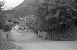 [A road in an unidentified village]