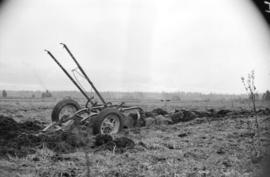 [Plow stuck in muddy field near Fry's Corner in the Fraser Valley]