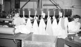 [Women marking bundles of clothes at Nelson's Laundry'