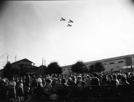 Planes flying over P.N.E. Administration building in Aviation and Transportation Day fly-past event