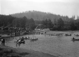 Hawick picnic [boaters and crowd on foot bridge]