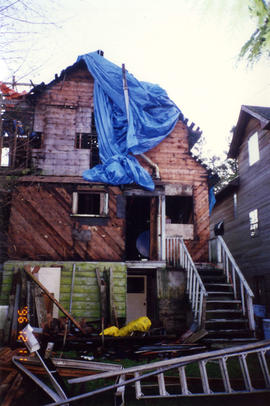 Exterior of fire damaged house at 331 East 38th Avenue