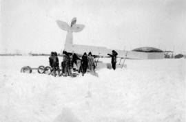 [Airforce plane being repaired in the snow]