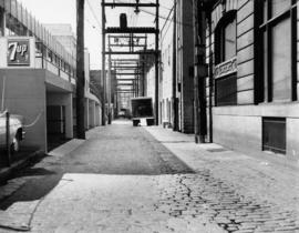 [View of cobblestone alley behind the 400 block Main Street, looking south]