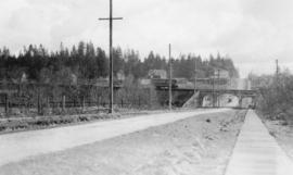 Park Avenue [later Boundary Road], Burnaby [showing streetcar, overpass, road, and sidewalk]