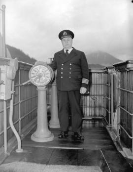 "Captain McLean [at the helm on] S.S. ""Prince Rupert"""