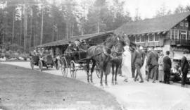 [View of road with horse-drawn buggy and motor vehicles at Stanley Park Pavillion]