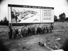 P.N.E. directors with sign marking the site of the new B.C. building