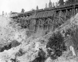 Filling Four Mile Creek trestle, mile 127.2 : The first train load