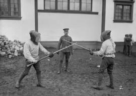 "29th Battalion and Yukon Detachment [""Pugil stick"" training to instruct in use of rifle..."
