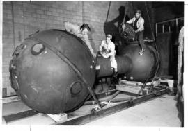 Men working on submersible Pisces-class vessel at North Vancouver plant of International Hydrodyn...