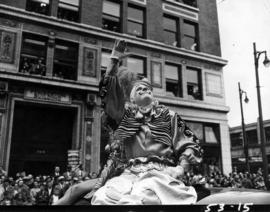 Clowns waving in 1953 P.N.E. Opening Day Parade
