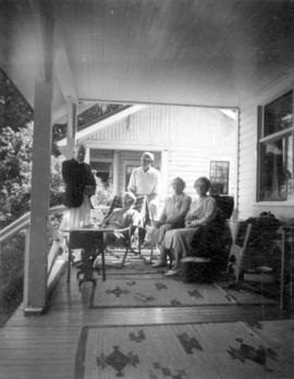 [Major and Mrs. Matthews, Mr. W.J. Twiss and others on the porch of the Twiss summer cottage]