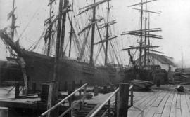 [Two barques docked at Hastings Mill]