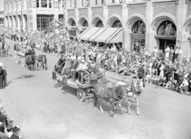 [Carriages and Carts carrying pioneeers in the Calgary Stampede parade]