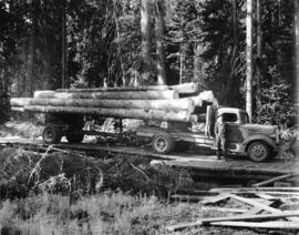 Eagle Lake Sawmills, Giscome, B.C. [truck with logs on plank road]