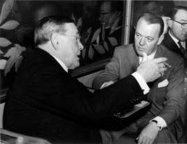 "[Hon. Eric W. Hamber speaking with another man during the launch of ""The Canadian""]"