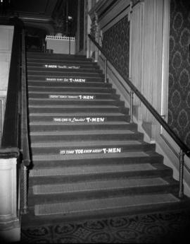 "[""T-Men"" movie advertisements on steps inside the Orpheum Theatre]"