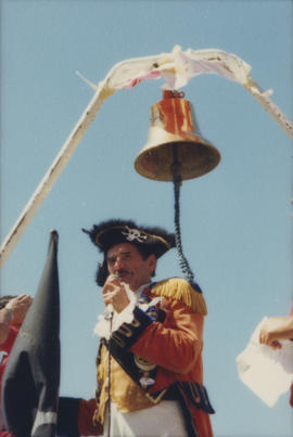 Man wearing pirate costume speaking into microphone