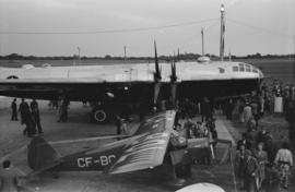 [A B-29 Bomber and another plane on display at airshow]