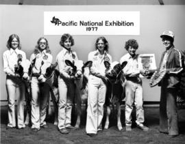 1977 P.N.E. 4-H Inter-Club Competition winners pose with livestock and prizes
