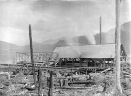 [Fraser Valley Sawmill, with partially cleared land in foreground and water and forest in backgro...