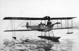 [Mr. Hoffman in tractor seaplane on the water]