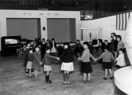 Japanese Canadian children in Manufacturer's building, Building G, during Japanese Canadian ...