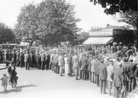 [Crowds watch the funeral procession for Major General R.G. Edwards Leckie in the 600 Block Howe ...