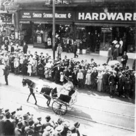 [A horse-drawn sulky in the 600 Block of Granville Street during a Victoria Day parade]