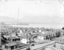 [View of West End buildings, Burrard Inlet, part of Stanley Park and North Shore mountains from r...